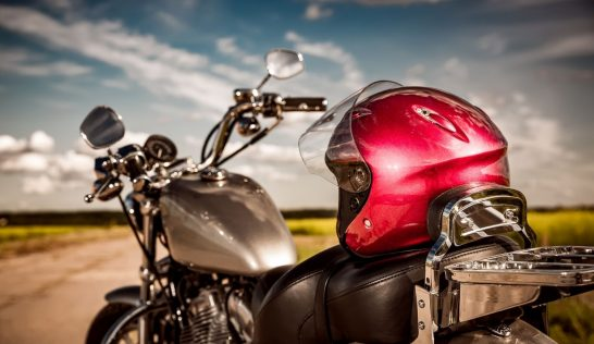 Motorcycle with helmet on the road.